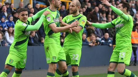 Norwich City attacker Marco Stiepermann is congratulated after his opener at Millwall Picture: Paul