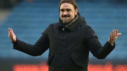 Norwich City head coach Daniel Farke joins in with the away fans, as they celebrate victory over Mil