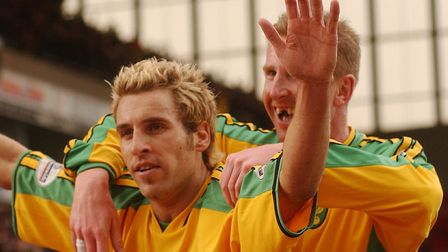 Darren Huckerby celebrates sealing a 3-1 win over Ipswich at Carrow Road in March 2004, with Iwan Ro