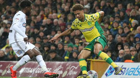 Norwich City left-back Jamal Lewis keeps Nathan Dyer busy during Swansea's Championship defeat at Ca
