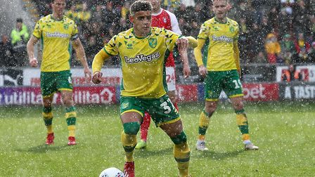The rain comes down as Max Aarons takes possession during Norwich City's 2-1 victory at Rotherham Un