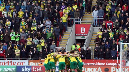 The Norwich City players speak in their pre-match huddle ahead of taking on - and beating - Rotherha