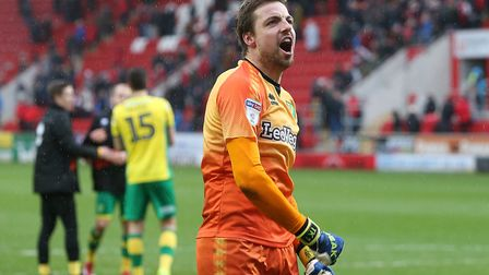 Tim Krul celebrates victory with the traveling Norwich City fans following full time at Rotherham. P