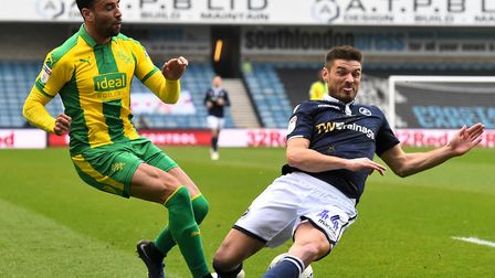 Norwich City loanee Ben Marshall, right, blocks a Hal Robson-Kanu cross during Millwall's 2-0 home w