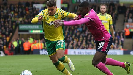 Max Aarons runs Bright Osayi-Samuel during Norwich City's 4-0 defeat of Queens Park Rangers at Carro