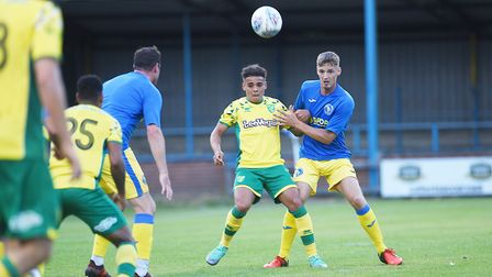 Max Aarons getting a taste of friendly action at King's Lynn Town Picture: Ian Burt