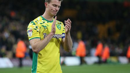 A dejected Christoph Zimmermann applauds the Norwich City fans following their late draw with Readin