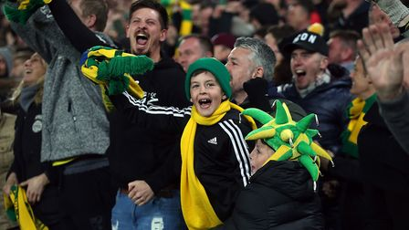 The Norwich fans celebrate their sides 1st goal during the Sky Bet Championship match at Carrow Road