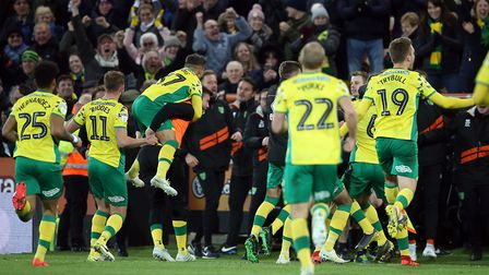 Wild scenes as the the Norwich players celebrate their side's 2nd goal scored by Christoph Zimmerman