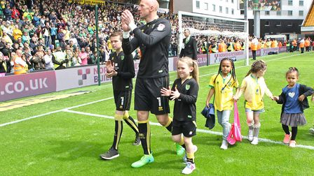 John Ruddy and his young family salute Norwich City fans after his farewell game in 2017 Picture: Pa