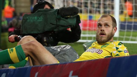 Teemu Pukki takes a moment with the advertising hoardings, as Norwich City beat Swansea to earn thei