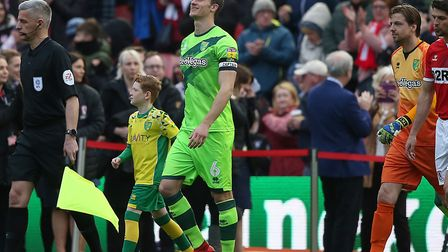Ready for battle - Christoph Zimmermann leads the Canaries out at Middlesbrough Picture: Paul Cheste