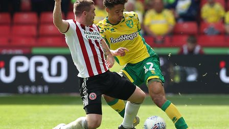 Sheffield United midfielder John Fleck, left, and Norwich City left-back Jamal Lewis are both away o