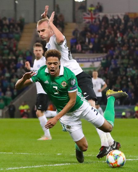 Norwich City left-back Jamal Lewis, front, played the full 90 minutes as Northern Ireland beat Eston