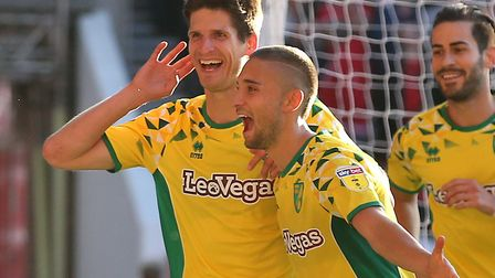 Norwich City defender Timm Klose, left, celebrates his late winner at Forest with Mo Leitner Picture