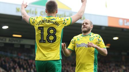 Marco Stiepermann, left, is congratulated on scoring Norwich City's second by Teemu Pukki, during th
