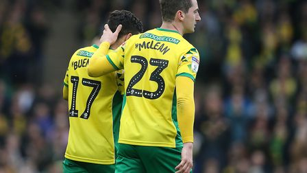 Kenny McLean consoles Emi Buendia following his red card - Norwich City's first of the Championship