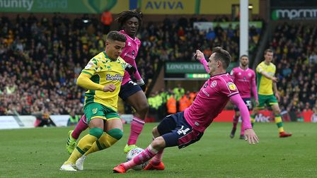 Josh Scowen tries to halt Max Aarons. Scowen was the player fouled by Emi Buendia for the Norwich Ci