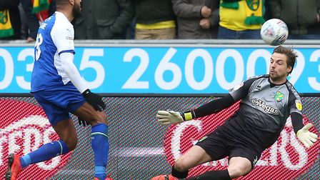 Norwich City keeper Tim Krul thwarts Leon Clarke in a 1-1 Championship draw at Wigan Athletic. Pictu