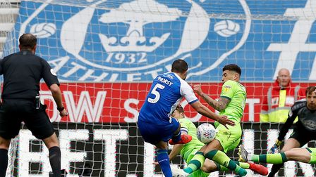 Sam Morsy unleashes the shot which deflected on to Ben Godfrey's arm and earned Wigan a penalty agai