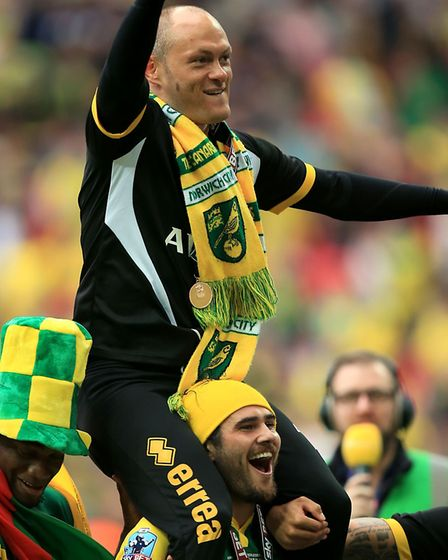 Alex Neil is held aloft by Bradley Johnson at Wembley. Within five months he was sold. Picture: Mike