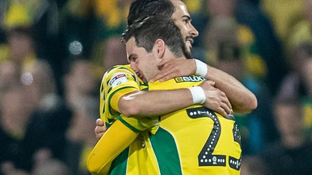 Mario Vrancic and Kenny McLean share a hug following Norwich City's dramatic draw with Sheffield Wed