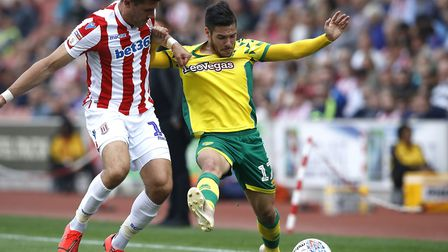Stoke defender Danny Batth (left) keeps a close watch on Norwich City star Emi Buendia during a 2-2