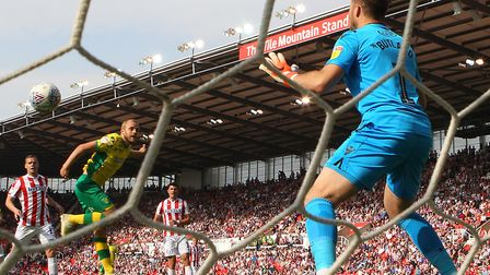 Teemu Pukki glances in a header to put Norwich City 2-1 up at Stoke Picture: Paul Chesterton/Focus I