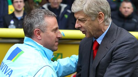 Neil Adams welcomes former Arsenal boss Arsene Wenger to Carrow Road during his spell as Norwich Cit