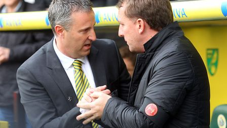 Liverpool boss Brendan Rodgers, right, and Neil Adams ahead of a 3-2 home defeat for Norwich City in
