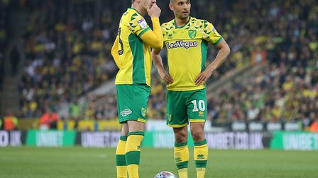 City midfielders Kenny McLean and Moritz Leitner, right, weight up a free-kick opportunity against t