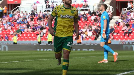 Teemu Pukki celebrates after putting Norwich 2-1 up at Stoke, in front of almost 3,000 travelling fa