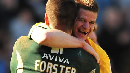 Michael Nelson and Fraser Forster celebrate Norwich City's promotion from league One at Charlton in