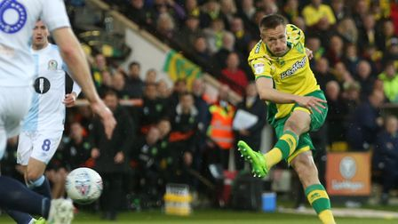 Marco Stiepermann smashed in his 10th goal of the season as Norwich City beat Blackburn 2-1 to seal