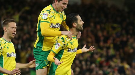 Marco Stiepermann, left, and Kenny McLean rush to congratulate Mario Vrancic on his brilliant strike