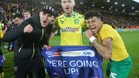 Dennis Srbeny, Tom Trybull and Onel Hernandez celebrate Norwich City's promotion to the Premier Leag