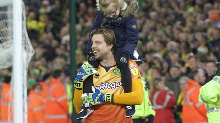Tim Krul celebrated Norwich City's promotion with his daughter at Carrow Road Picture: Alan Stanford