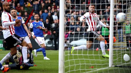 Sheffield United's Scott Hogan (centre right) scores his side's first goal during a 2-0 win over Ips