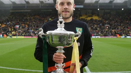 Teemu Pukki with the Barry Butler Memorial Trophy after being voted Player of the Season for 2018-19