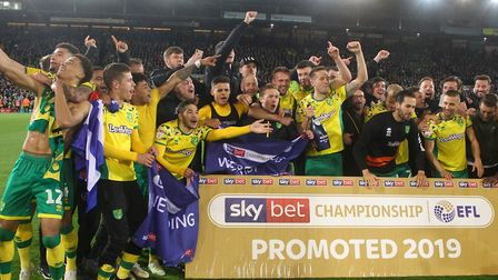 The Norwich players celebrate promotion at the end of the Sky Bet Championship match at Carrow Road,