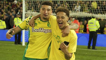 Ben Godfrey of Norwich City celebrates with Jamal Lewis of Norwich City (right) after winning promot