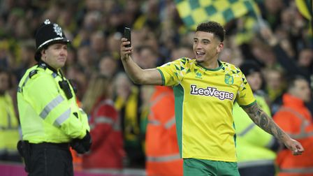 Ben Godfrey of Norwich City celebrates with a selfie after winning promotion to the Premiership duri