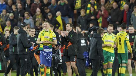 Norwich City players celebrate after winning promotion to the Premiership during the Sky Bet Champio