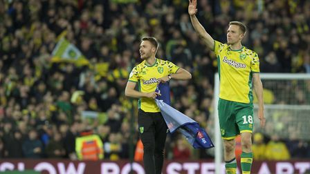 Tom Trybull of Norwich City (left) and Marco Stiepermann of Norwich City celebrate after winning pro
