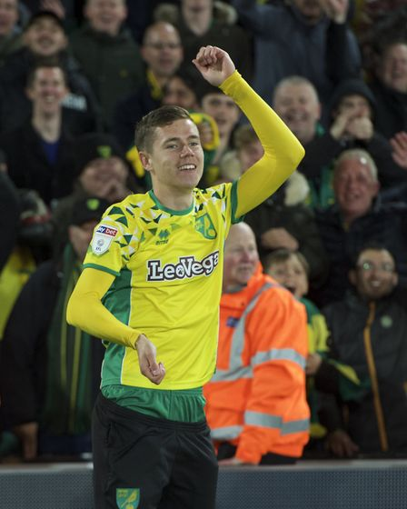 Todd Cantwell of Norwich City celebrates after winning promotion to the Premiership in the Sky Bet C
