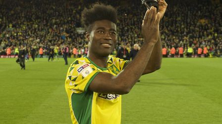 Alexander Tettey of Norwich City celebrates with fans after winning promotion to the Premiership in