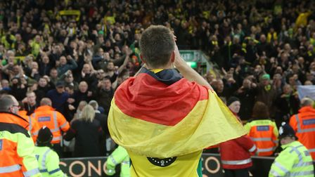 Christoph Zimmermann of Norwich celebrates promotion at the end of the Sky Bet Championship match at