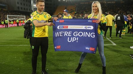 Tom Trybull of Norwich celebrates promotion with his partner at the end of the Sky Bet Championship