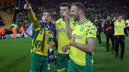 Kenny McLean of Norwich, Grant Hanley of Norwich and Jordan Rhodes of Norwich celebrate promotion at
