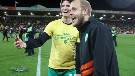 Timm Klose of Norwich and Teemu Pukki of Norwich celebrate promotion at the end of the Sky Bet Champ